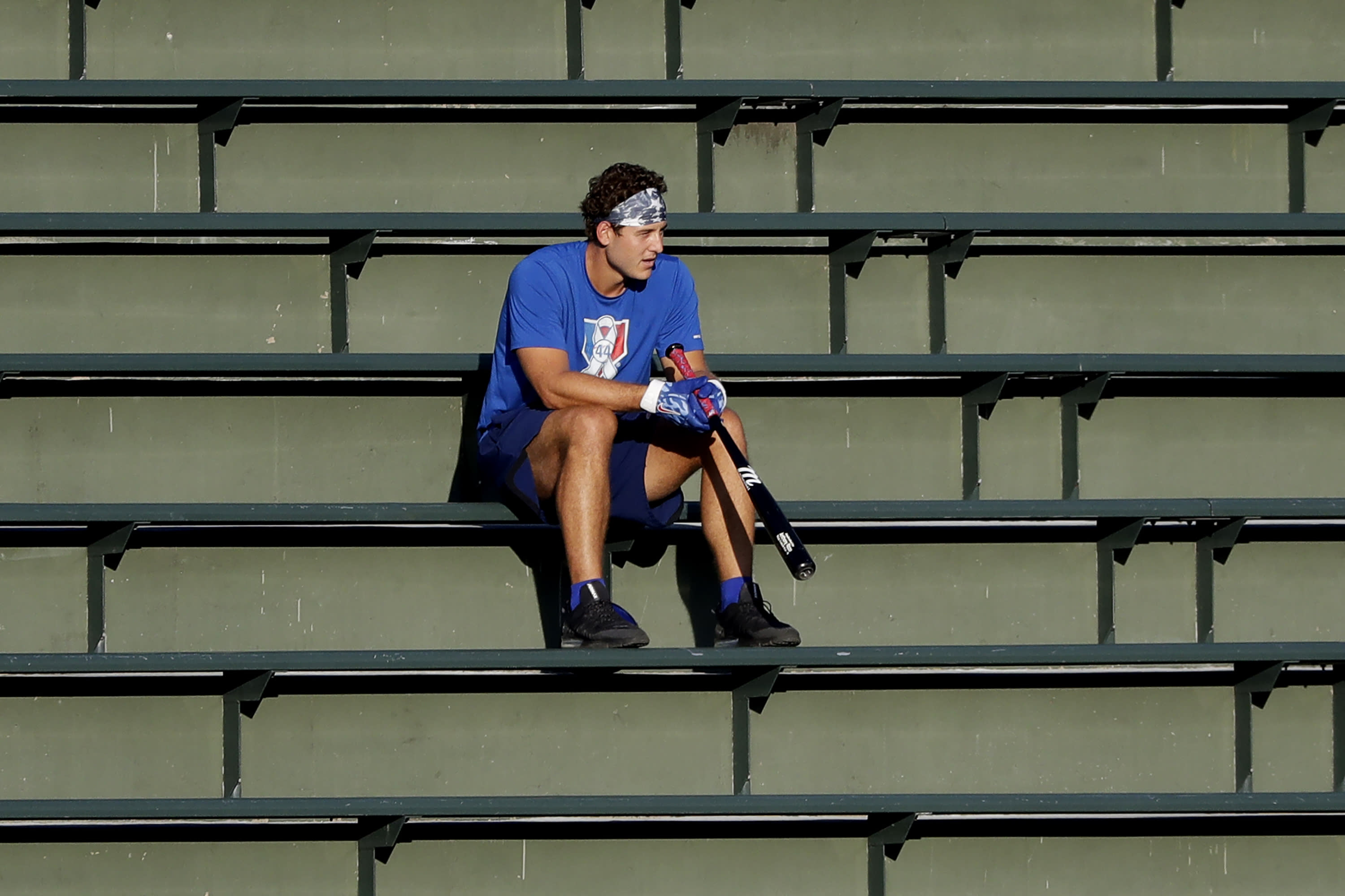 Chicago Cubs infielder Anthony Rizzo watches teammates during baseball practice at Wrigley Field in Chicago, Friday, July 10, 2020. (AP Photo/Nam Y. Huh)