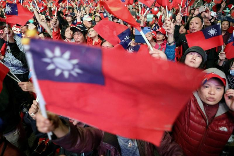 FILE PHOTO: Supporters of Kuomintang party's presidential candidate Han Kuo-yu wave Taiwanese flags during an election rally in Taipei