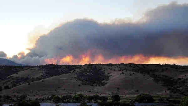 More homes evacuated in Western wildfires