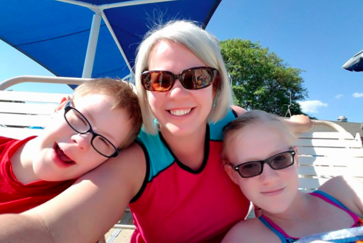 Kristen Miller Rumphol (center) with her kids, including Brandon (left), at the pool