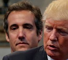 Michael Cohen jailed for three years as he says it was his duty to cover up Donald Trump's 'dirty deeds'