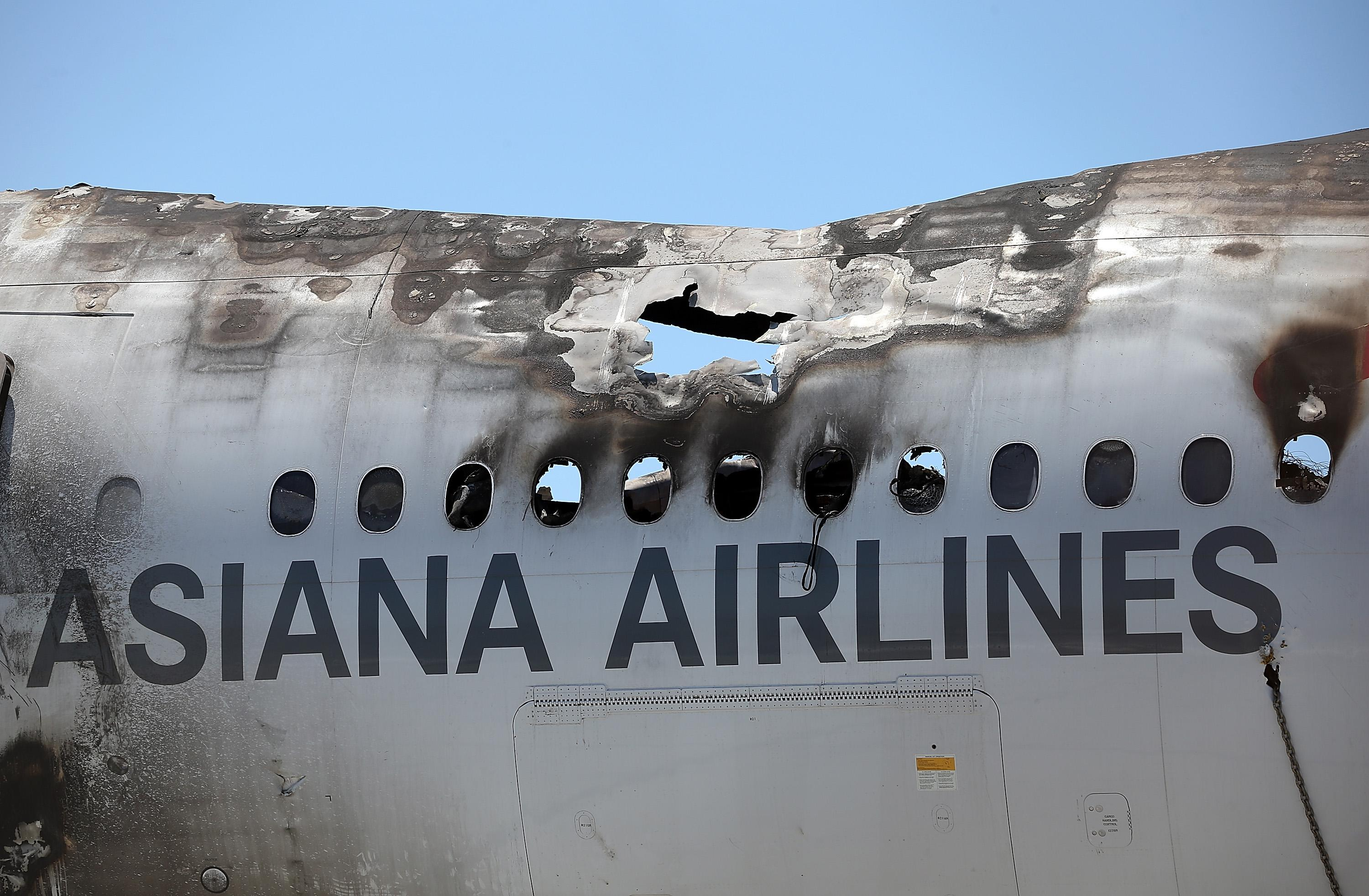 The wrecked fuselage of Asiana Airlines flght 214 sits in a storage area at San Francisco International Airport, on July 12, 2013