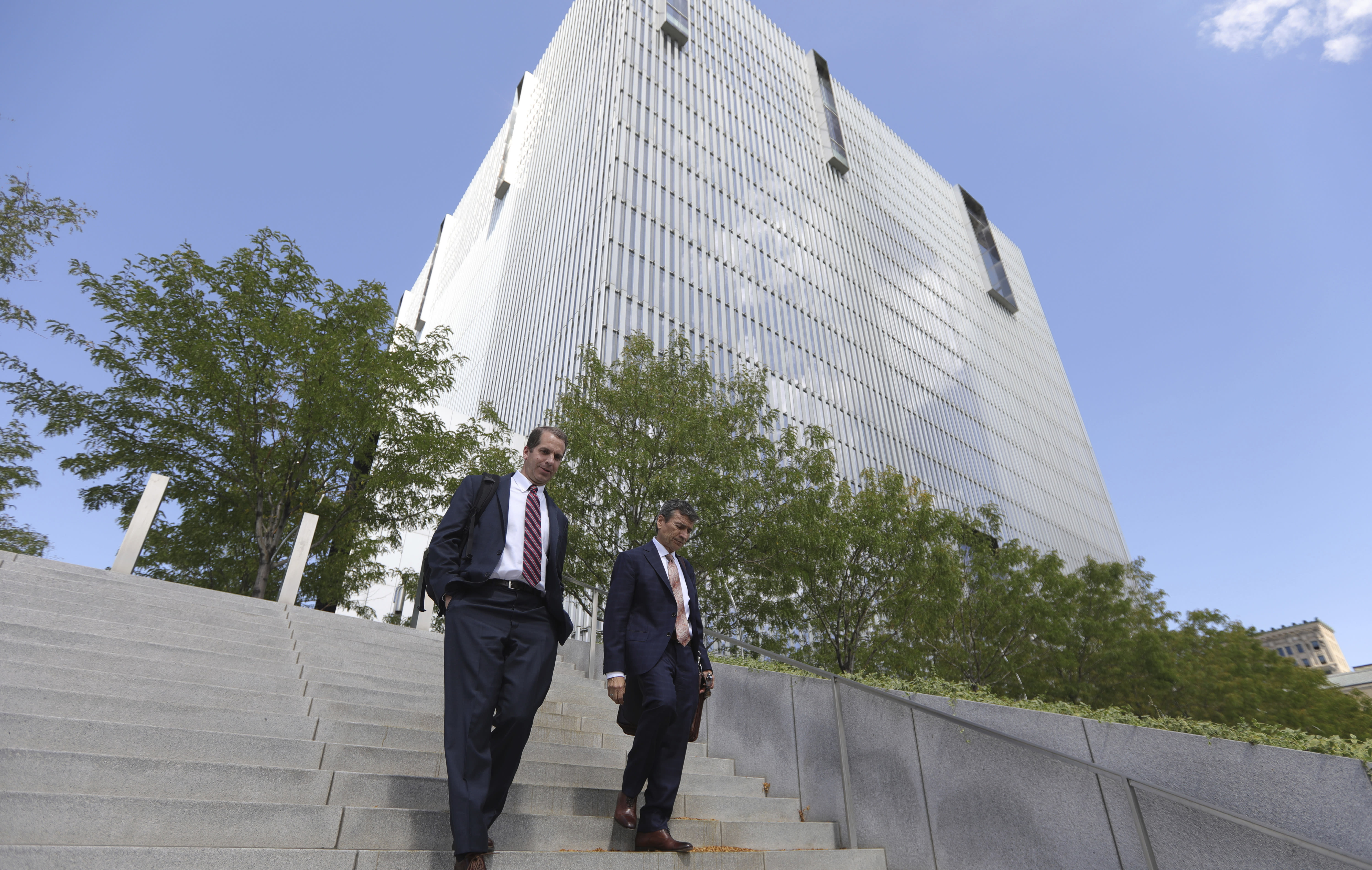 Aaron Shamo's defense attorney Greg Skordas, right, walk from the federal courthouse Thursday, Aug. 29, 2019, Salt Lake City. A jury is deliberating in the case of a Utah man accused of running a multimillion-dollar opioid ring that shipped fake prescription drugs across the country, causing at least one fatal overdose. Prosecutors said during closing arguments that Shamo's operation helped fuel the nation's opioid epidemic by making hundreds of thousands of pills available to addicts and other users. (AP Photo/Rick Bowmer)