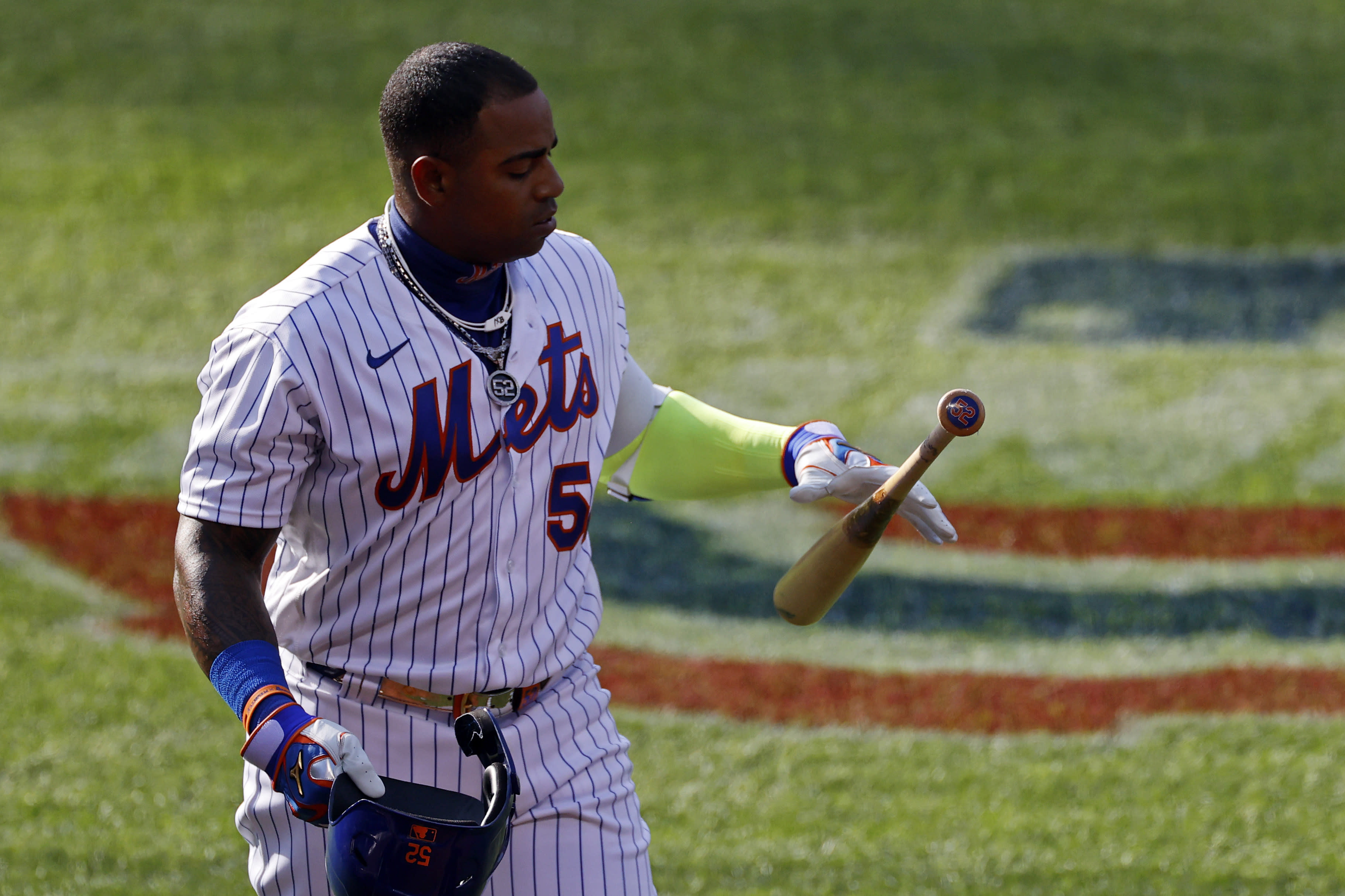 New York Mets' Yoenis Cespedes reacts after striking out against the Atlanta Braves during the sixth inning of a baseball game Saturday, July 25, 2020, in New York. (AP Photo/Adam Hunger)