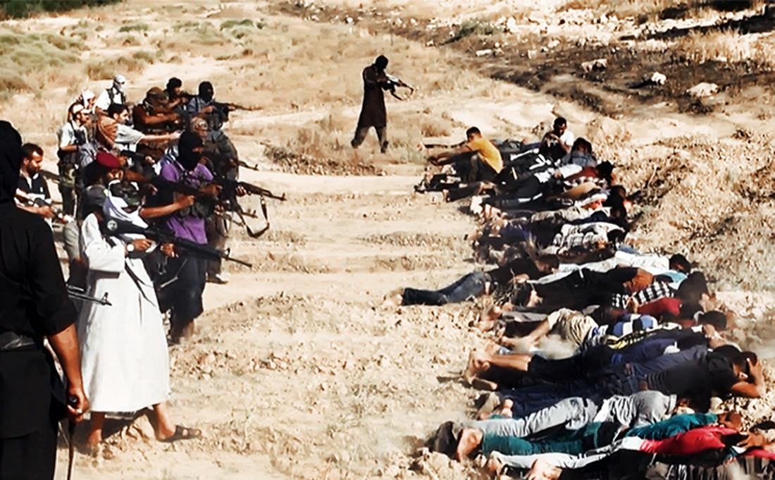 An image uploaded on June 14, 2014 on the jihadist website Welayat Salahuddin allegedly shows militants of the Islamic State of Iraq and the Levant (ISIL) executing dozens of captured Iraqi security forces members in Salaheddin province (AFP Photo/)