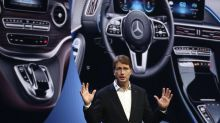 Daimler reports its profit is down — by half