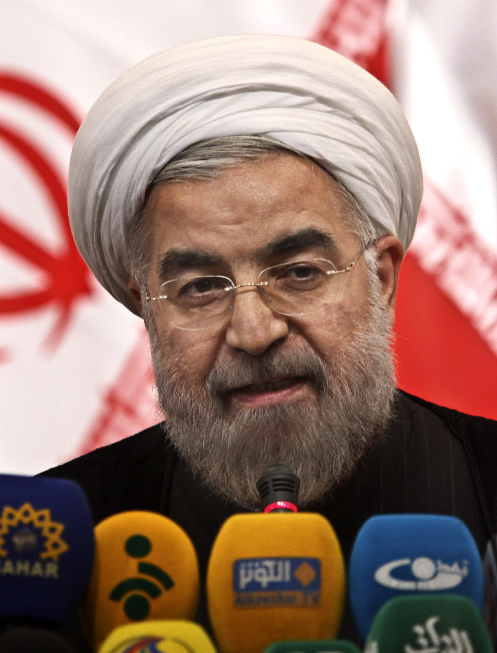 "Iranian newly elected President Hasan Rowhani, listens during a press conference, in Tehran, Iran, Monday, June 17, 2013. Rowhani showcases his reformist image by promising a ""path of moderation,"" the easing of nuclear tensions and steps to narrow the huge divide with the United States. He also made clear where he won't go, saying he opposes any halt to uranium enrichment, at the heart of the nuclear standoff. (AP Photo/Ebrahim Noroozi)"