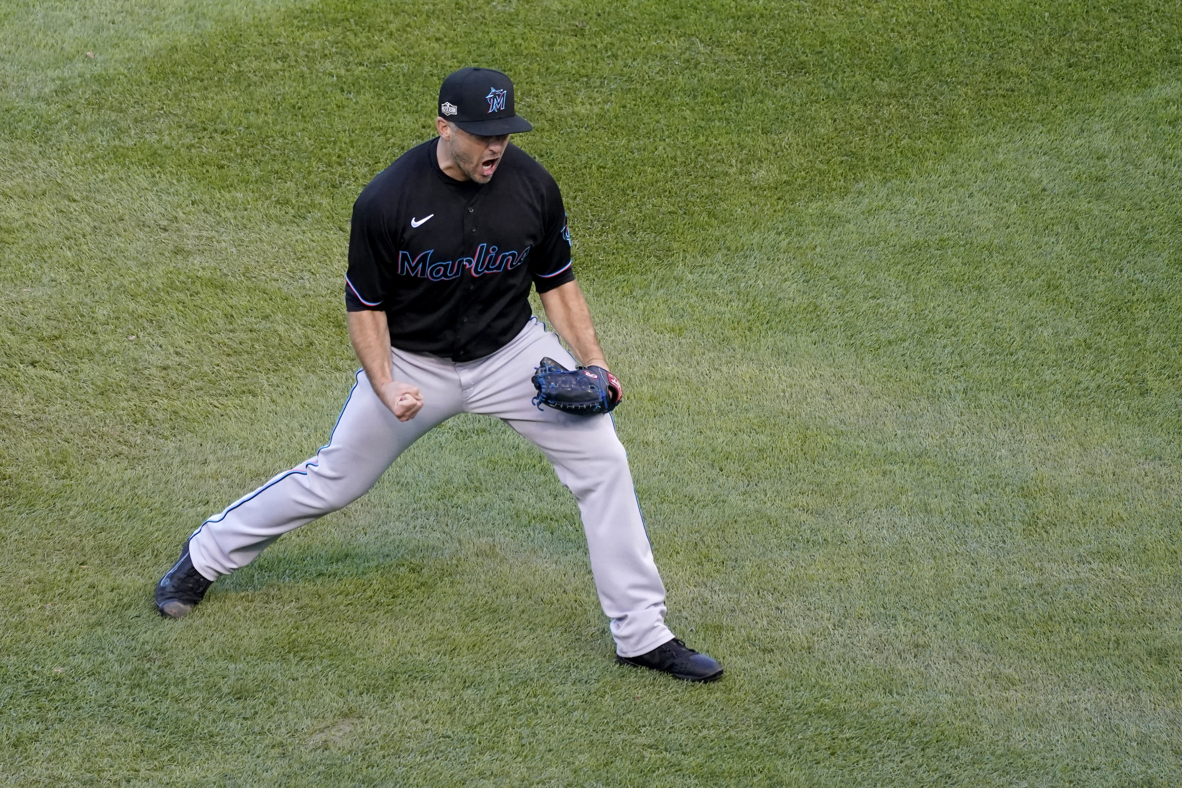 Miami Marlins relief pitcher Brandon Kintzler celebrates a 2-0 victory over the Chicago Cubs in Game 2 of a National League wild-card baseball series Friday, Oct. 2, 2020, in Chicago. The Marlins won the series 2-0 to advance to the division series. (AP Photo/Nam Y. Huh)