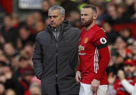 Manchester United's Wayne Rooney prepares to come on as a substitute as Manchester United manager Jose Mourinho looks on