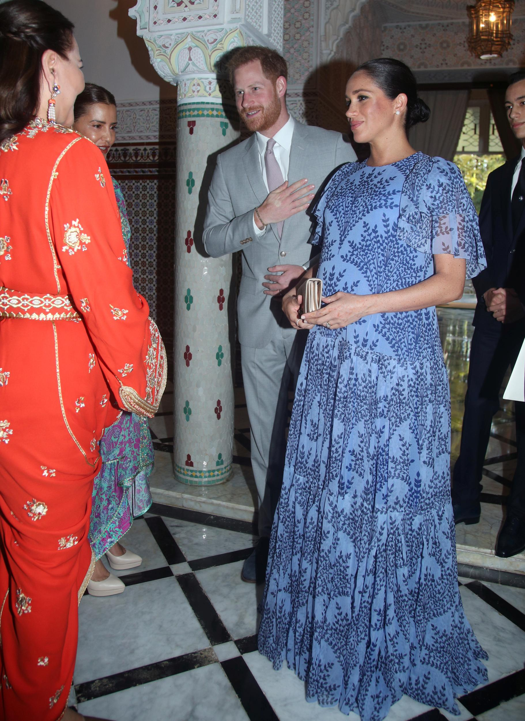 Britain's Meghan, Duchess of Sussex and Prince Harry the Duke of Sussex greet Princess Lalla Meryem and Princess Lalla Hasna during an audience with King Mohammed VI of Morocco at his residence in Rabat, Morocco February 25, 2019. Yui Mok/Pool via REUTERS