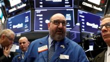 Wall Street tumbles on chip stocks, commodities soften after wild ride