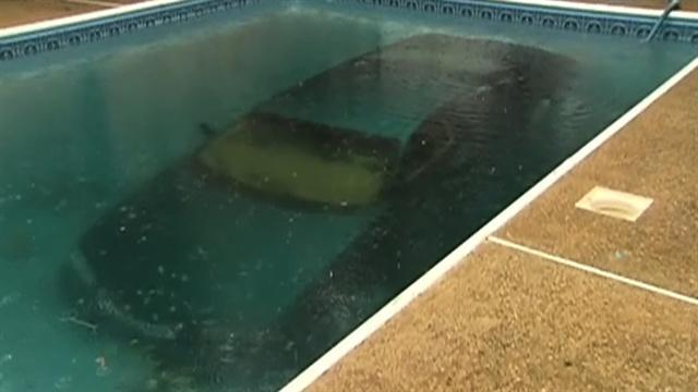 Car crashes into swimming pool