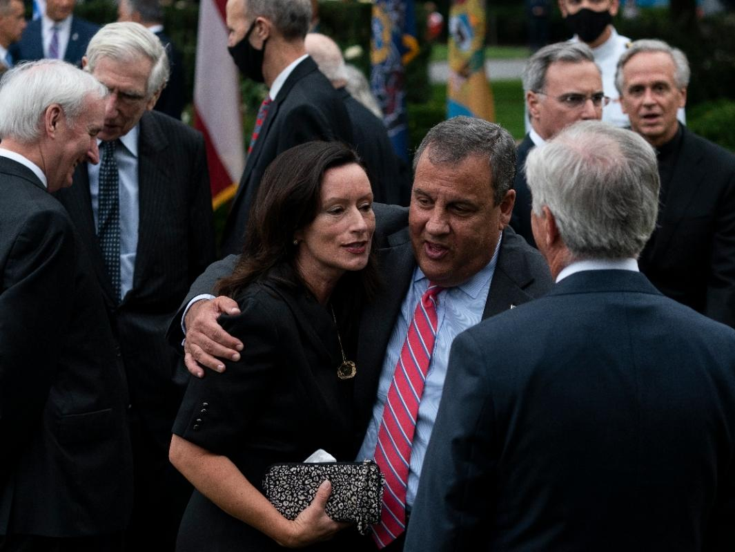 In this Saturday, Sept. 26, 2020, photo former New Jersey Gov. Chris Christie, front second from right, speaks with others after President Donald Trump announces Judge Amy Coney Barrett as his nominee to the Supreme Court in the Rose Garden.
