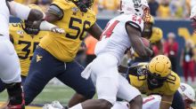 West Virginia suspends 11 for opener; bans not tied to virus