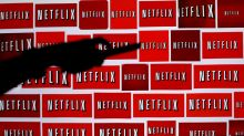 Netflix shares hit record as more subscribers sign up