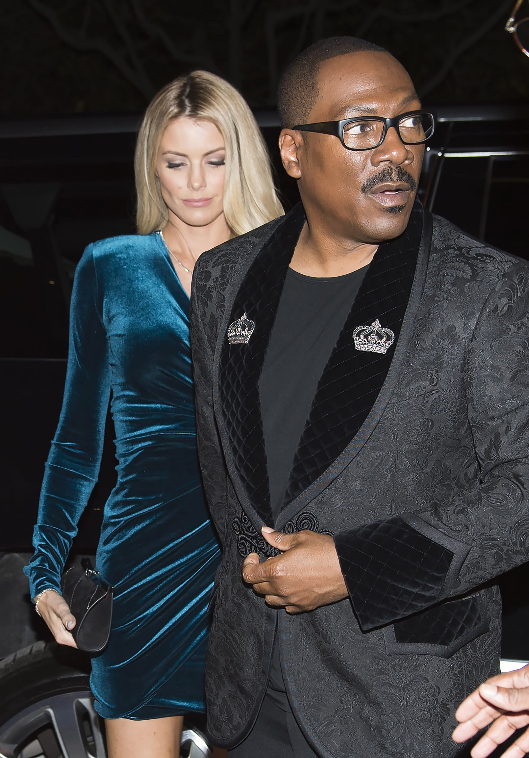 "Actor Eddie Murphy arrives with his girlfriend Paige Butcher on the red carpet for the new movie ""Dolemite Is My Name"" in Toronto, on Saturday, Sept. 7, 2019. (Nathan Denette/The Canadian Press via AP)"