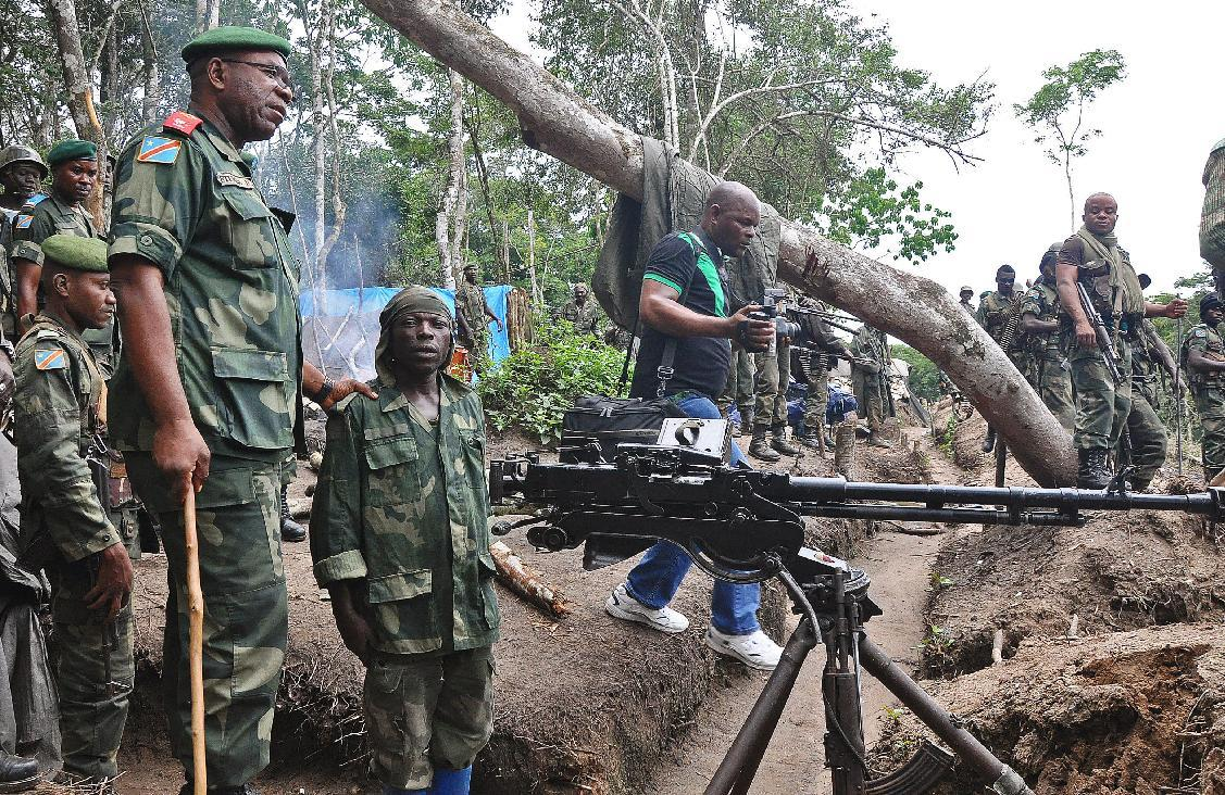 Lieutenant General Didier Etumba Longila (left), chief of the general staff of DR Congo armed forces, meets soldiers in Beni in North Kivu, in May last year