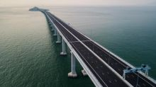 'Yawn cams' and heart monitors: five key facts about the world's longest sea bridge