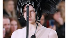 A Model Walked Down the Runway Wearing a Bag on Her Head