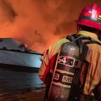 Families of dive boat fire victims react as captain charged with manslaughter over 34 deaths