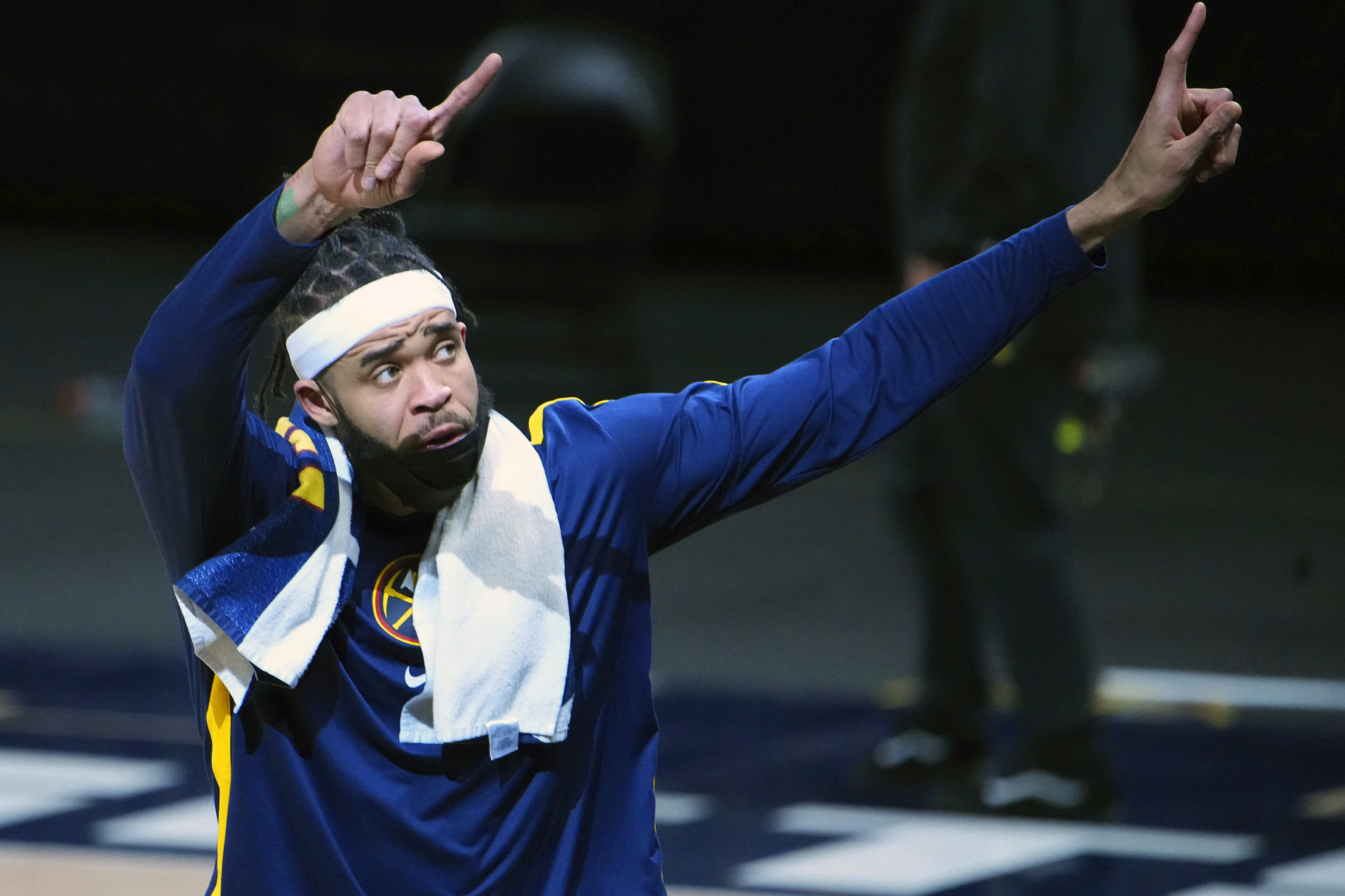 Denver Nuggets center JaVale McGee (34) celebrates a win against the San Antonio Spurs following an NBA basketball game Wednesday, April 7, 2021, in Denver. (AP Photo/Jack Dempsey)