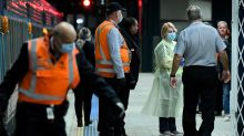 Train passenger with virus symptoms rushed from Sydney's Central Station
