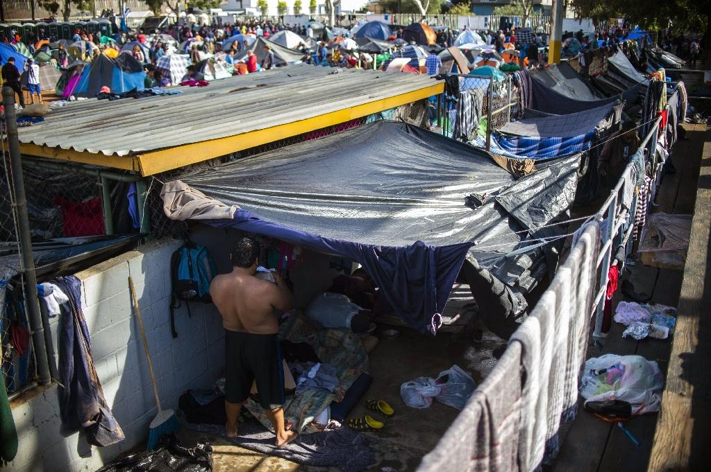 Central American migrants are crammed into a makeshift shelter in Tijuana, Mexico as they wait in hope of crossing into the US (AFP Photo/PEDRO PARDO)