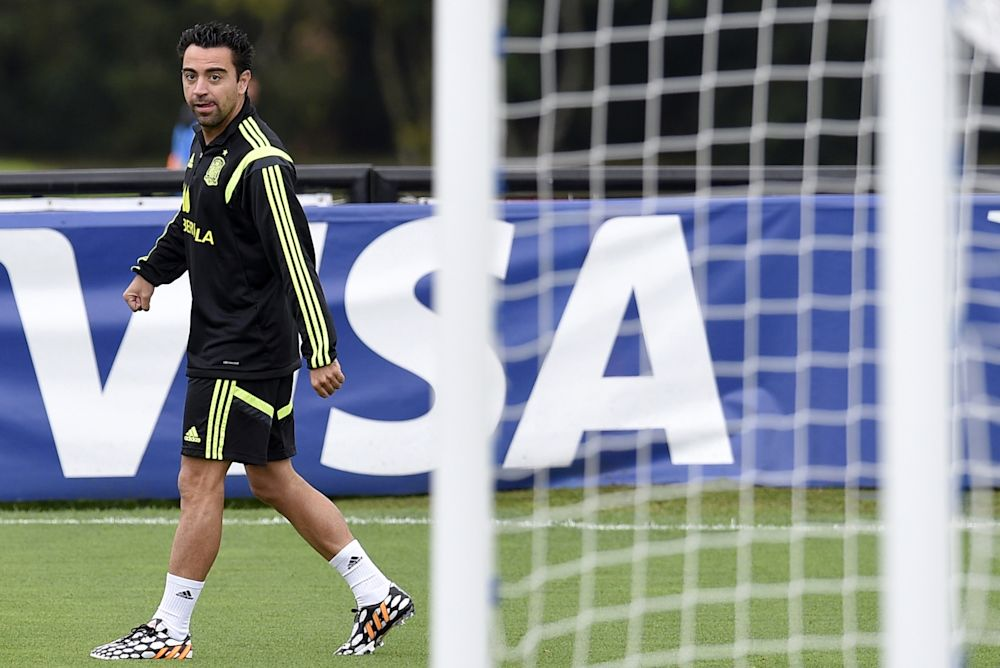 Spain's midfielder Xavi attends a training session at the CT do Caju in Curitiba during the 2014 FIFA World Cup football tournament on June 20, 2014