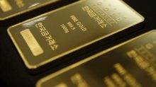 Gold heads to first weekly gain in four weeks after Fed rise