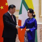 China's Xi vows 'new era' of Myanmar ties after red carpet welcome