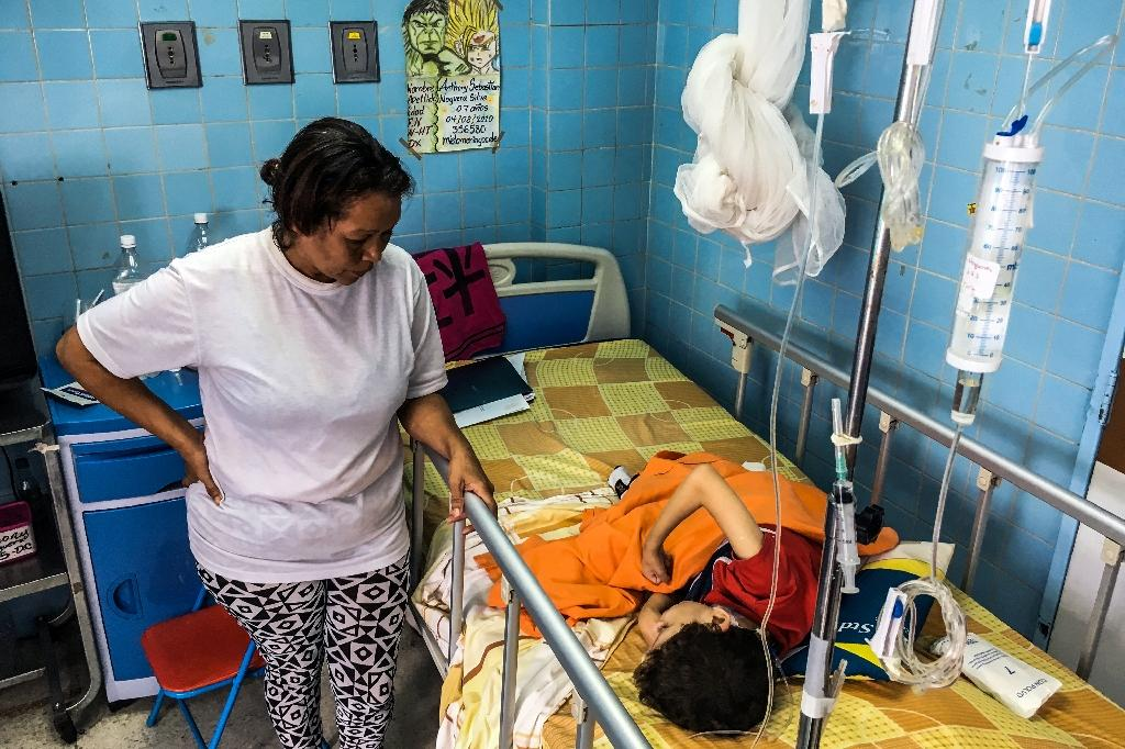 Venezuela's Pharmaceutical Federation says just 20 percent of the drugs and medical equipment needed in hospitals and pharmacies across the oil-rich state are available (AFP Photo/FEDERICO PARRA)