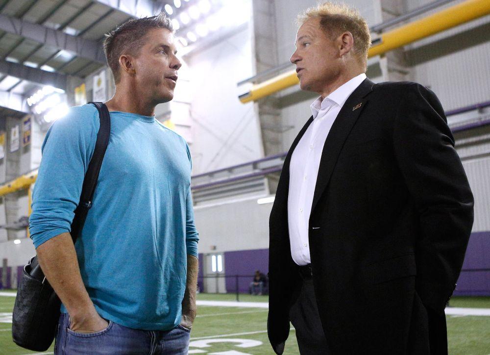 New Orleans Saints head coach Sean Payton, left, talks to LSU head coach Les Miles during NFL football pro day, Wednesday, April 9, 2014, in Baton Rouge, La