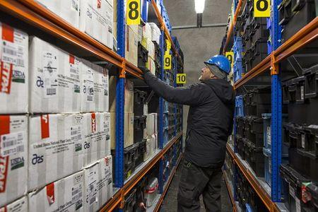 Asmund Asdal Senior Adviser from NordGen inspects seeds in storage at the international gene bank Svalbard Global Seed Vault (SGSV) near Longyearbyen on Spitsbergen, Norway, October 20, 2015. REUTERS/Anna Filipova