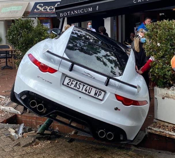 Jaguar driver with '2FAST4U' number plate crashes £60,000 car into cafe