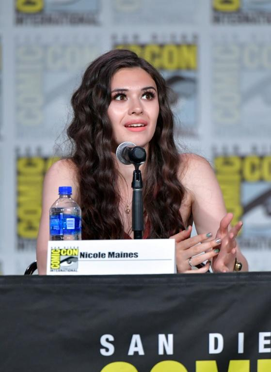 "Nicole Maines portrays television's first trans superhero on ""Supergirl"" -- she is seen here at the 2019 Comic-Con International in San Diego in July 2019 (AFP Photo/Amy Sussman)"
