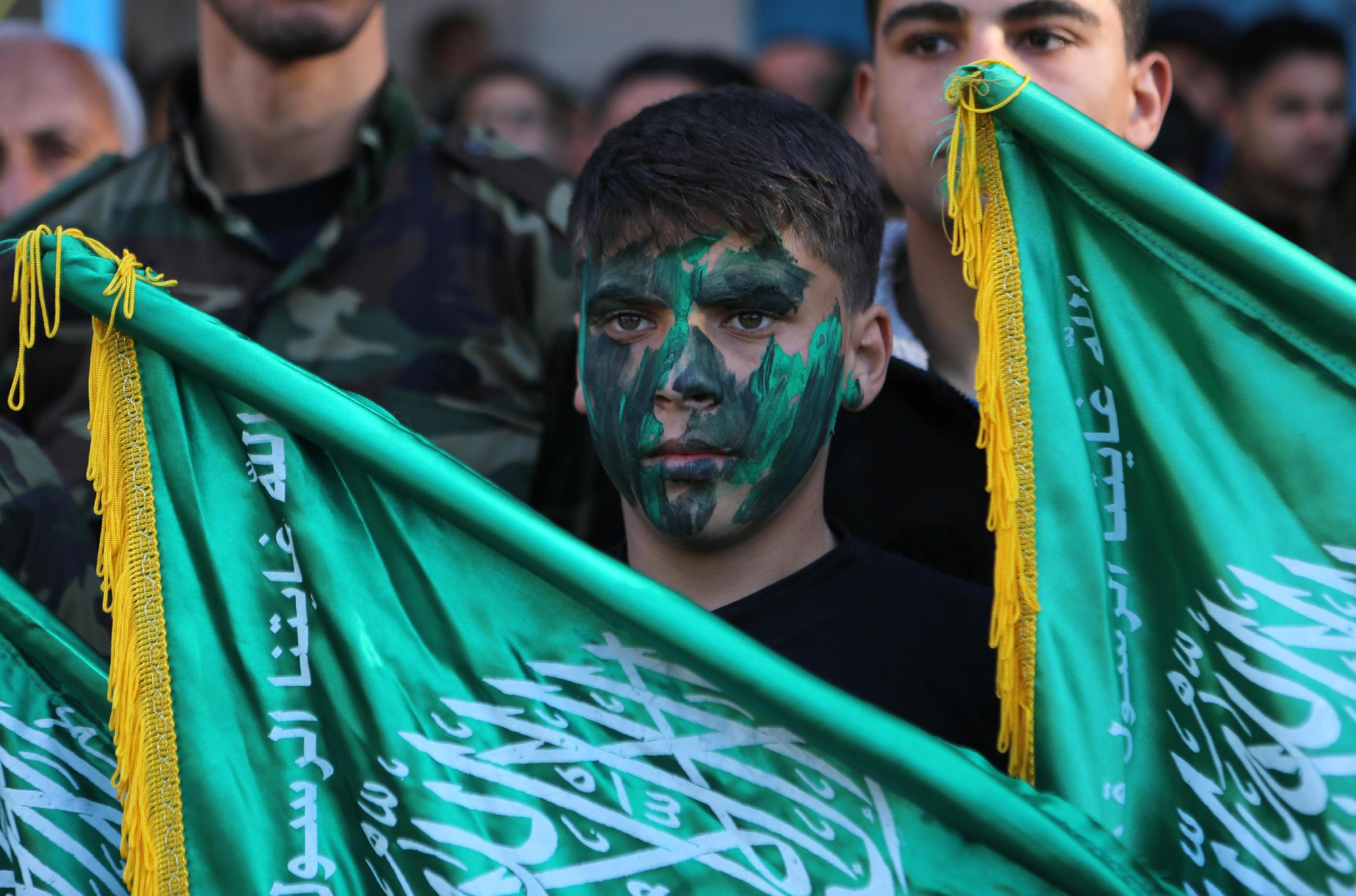 Hamas supporters rally near the Rafah border between southern Gaza and Egypt on February 5, 2015 to condemn the decision of an Egyptian court to ban the armed wing of the Palestinian Islamist movement