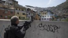 Brazil's army return to Rio favela amid clashes between gangs and police