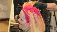 Dedicated teacher gets a unicorn-pink hair makeover after students improve test scores