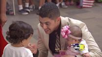 Valley soldier holds his daughter for the first time