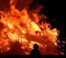 Firefighters contain more of deadly Los Angeles wildfire