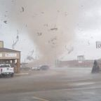 Tornado tears through Arkansas city, prompting curfew and National Guard response