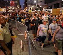 The Latest: Protesters leave mall, march on suburban street