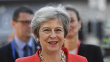 The Latest: Pound falls after May says Brexit at 'impasse'