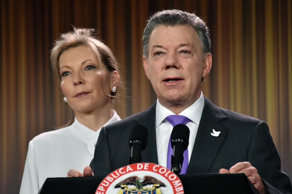 Colombian president Juan Manuel Santos, pictured with his wife Maria Clemencia Rodriguez on October 7, 2016, will donate his Nobel Peace Prize money to victims of his country's conflict