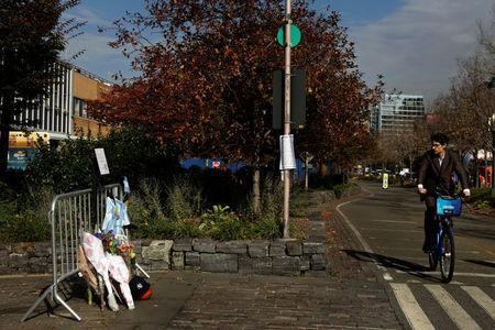 A bicyclist passes a memorial on West Street two days after a man driving a rented pickup truck mowed down pedestrians and cyclists on a bike path alongside the Hudson River, in New York, U.S., November 2, 2017. REUTERS/Lucas Jackson
