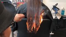 Watch the moment a stylist uses fire to rid his client of her split ends