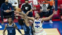 Short-handed 76ers booed at home in loss