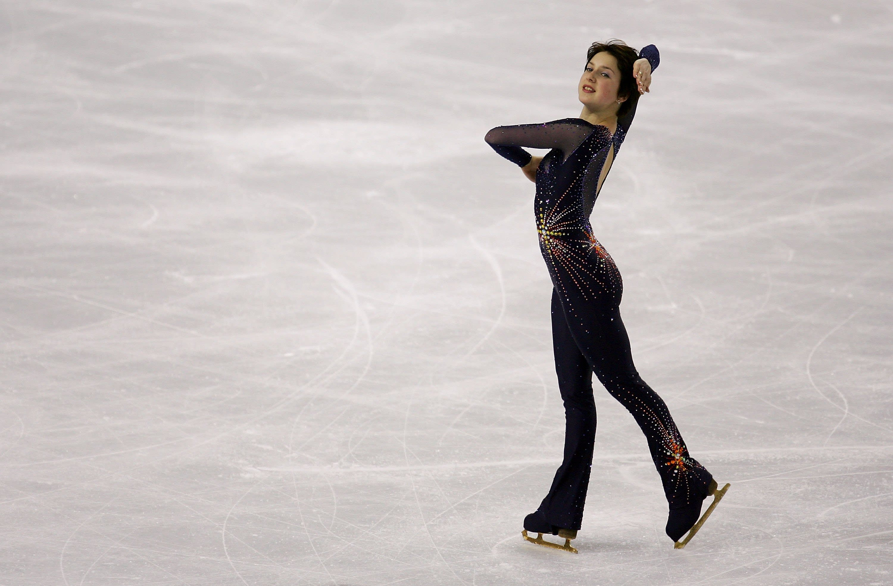 As soon as the skirt-only ice age melted away, Russian skater Irina  Slutskaya wore a fiery bodysuit at the 2006 Olympics.