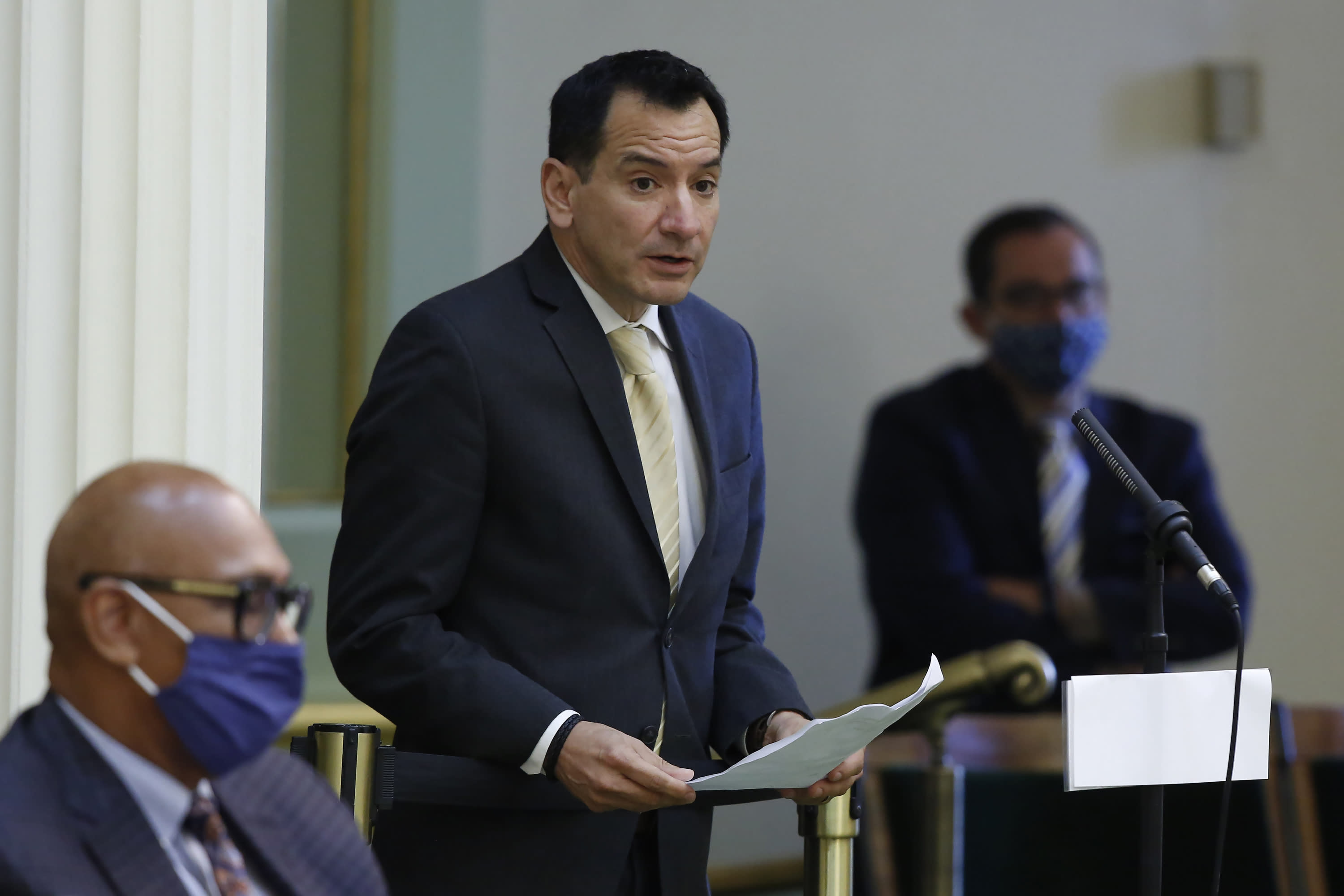FILE - In this June 15, 2020, file photo, Assembly Speaker Anthony Rendon, D-Lakewood, urges lawmakers to approve the state budget bill, at the Capitol in Sacramento, Calif. A coronavirus outbreak in the California Legislature has indefinitely delayed the state Assembly's return to work from a scheduled summer recess. Rendon's office confirmed five people who work in the Assembly have tested positive for the coronavirus. They include Assemblywoman Autumn Burke, who is believed to have contracted the virus while on the Assembly floor last month. (AP Photo/Rich Pedroncelli, File)