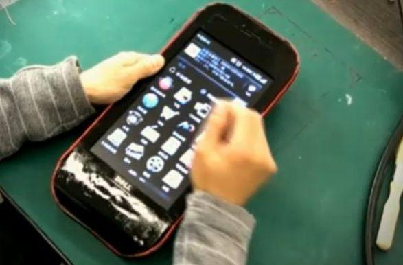 Dell netbook modded into a rather large handset (video)